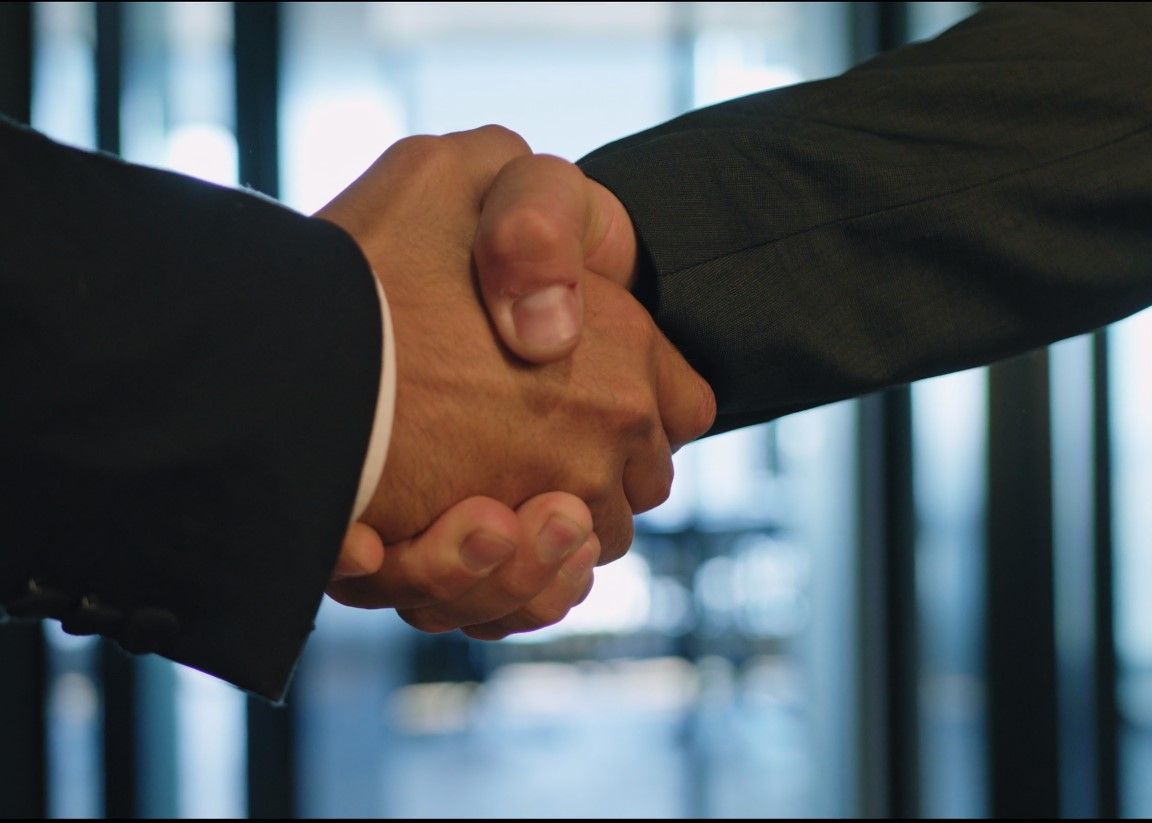 Many a corporate video includes a handshake